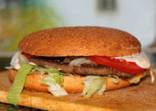 The Cheesburger. On the foreground Royalty Free Stock Photography