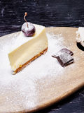Cheescake with Blueberry sprinkled with icing sugar Royalty Free Stock Images