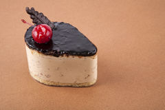 Cheescake on brown. Sweet cheescake on brown background Royalty Free Stock Photos