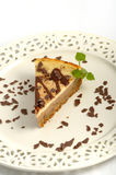 Cheescake with chocolate. A slice of cheesecake on a plate Stock Photo