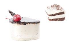 Cheescake and tiramisu. Isolated on white background Stock Images