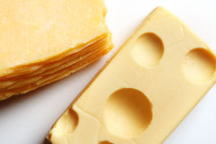 Cheese. Two blocks of cheese against white background royalty free stock image