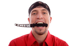 Cheese. Portrait of a young man with headscarf and cheese knife Royalty Free Stock Images