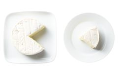 Cheese. Shot in studio with white perspex and white plates as background Stock Image