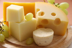 Cheese. Different types of cheese on a wooden board Stock Photography