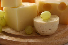 Cheese. Different types of cheese on a wooden board Stock Photo