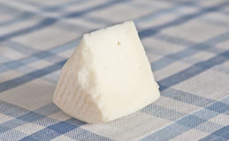 Cheese. Artisan cheese on blue tablecloth royalty free stock image