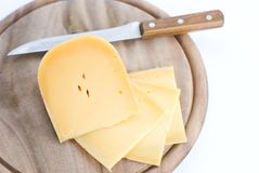 A cheese. On the wooden board isolated on white background Stock Images