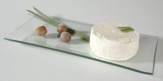 Cheese. Elegantly displayed on glass platter Stock Image