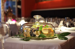 Cheese. Glass bell chesee display in a restaurant Royalty Free Stock Photo