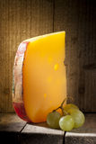 Cheese. Stillife of a piece of cheese and seedless grapes Royalty Free Stock Photography