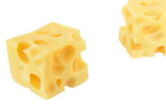 Cheese. Two cubes of Swiss cheese isolated on white background Stock Photo