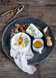 Cheese. With nuts, honey on a metal plate Royalty Free Stock Photography