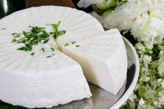 Cheese. Salty hard cheese, Greek style, on a table Stock Photo