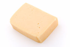 Cheese. Whole piece of cheese on white Stock Image