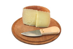 Cheese. And knife Royalty Free Stock Photos