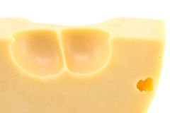 Cheese. An extreme close-up of yellow cheese with big wholes Stock Photography