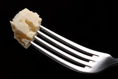 Cheese. With fork in close Stock Photo