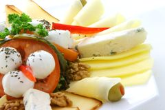 Cheese. Nuts,cheese and fresh vegetables Royalty Free Stock Photography
