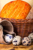 Cheese allsorts in a wicker basket on yellow autumn leaves with Royalty Free Stock Photos