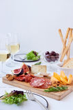 Cheese And Cured Meat Board Royalty Free Stock Photo
