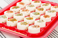 Cheese Appetisers. Soft cheese topped with herbs and spices Royalty Free Stock Photo