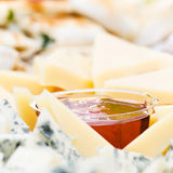 Cheese appetizer with honey macro. Dor Blue Cheese plate with  h Stock Images