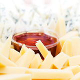 Cheese appetizer with honey macro. Dor Blue Cheese plate with  h Royalty Free Stock Image