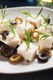 Cheese appetizer with olives and rosemary Stock Photography