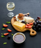 Cheese appetizer selection or whine snack set Royalty Free Stock Images