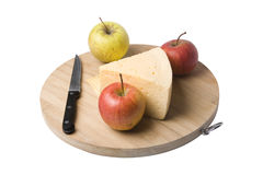 Cheese and apples. Laying on the wooden block Stock Photography