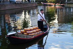 Cheese arrives to the cheese market by boat. Alkmaar, Netherlands - August 10, 2012: Cheese arrives to the cheese market by boat. Every friday morning there is a stock photos
