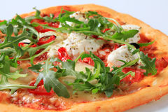 Cheese and arugula pizza. Cheese pizza sprinkled with fresh arugula royalty free stock photos
