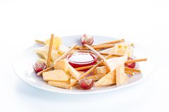 Cheese assorted with crackers, grapes and jam on a white backgro Stock Image