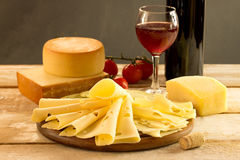 Cheese. Assorted cheese with red wine on a rustic table stock image