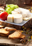 Cheese assortment. On a rustic background Royalty Free Stock Photo