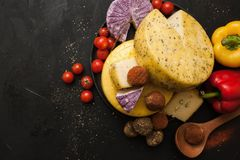 Cheese assortment. Dairy milk products. Top view. Healthy food with variety of vegetables around Stock Photos