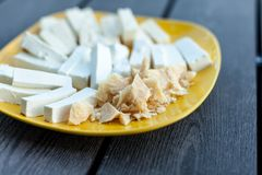 Cheese Assortment on a dark background, selective focus Royalty Free Stock Images
