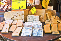 Cheese assortment at market stall Stock Photos