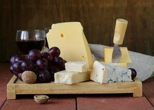 Cheese assortment served on a wooden board Stock Photography