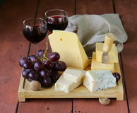 Cheese assortment served on a wooden board Royalty Free Stock Photos
