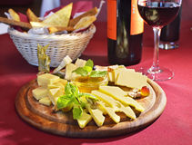 Cheese in assortment with wine glass Royalty Free Stock Photos