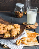 Cheese bagels biscuits from short pastry rolls, milk, dessert Stock Photo