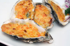 Cheese-Baked Oysters Royalty Free Stock Photos
