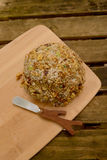 Cheese Ball as side dish on rustic table Stock Photo