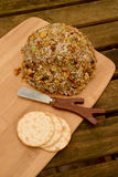 Cheese ball on cutting board Royalty Free Stock Photo