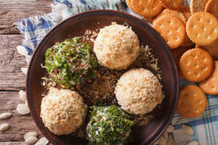 Cheese balls with crackers, herbs and seeds close-up. horizontal Stock Photography