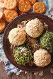 Cheese balls with crackers, herbs and seeds close-up. vertical t Royalty Free Stock Images