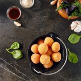 Cheese Balls in Metal Bowler on Dark Background royalty free stock images