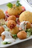 Cheese balls and potato puree. With paprika cream and white sauce Stock Photo